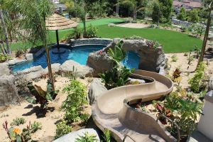 Bad Ass Backyard #013 by Green Scene Landscape and Swimming Pools